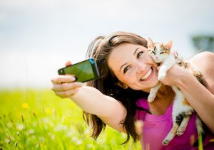 woman taking selfie with her cat