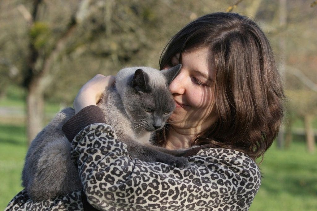 cat and woman hugging