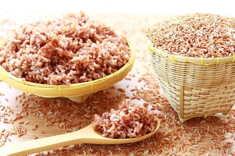 brown rice on wooden ladle