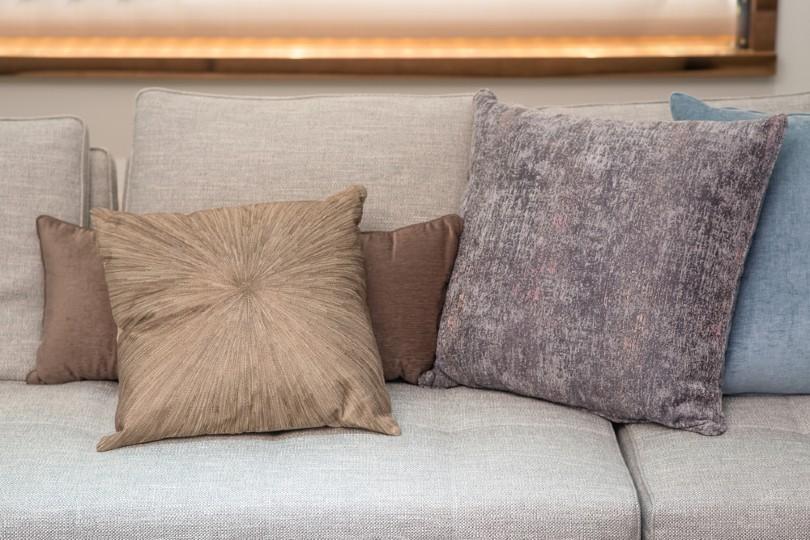 soften pillow decor on the grey sofa